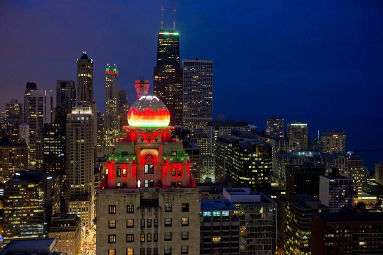 the dome of the intercontinental hotel and the skyline of chicago including the hancock center