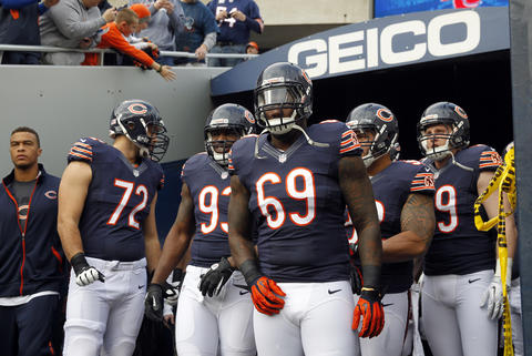 Chicago Bears defensive tackle Henry Melton (69) and the defense take the field Sunday at Soldier Field.