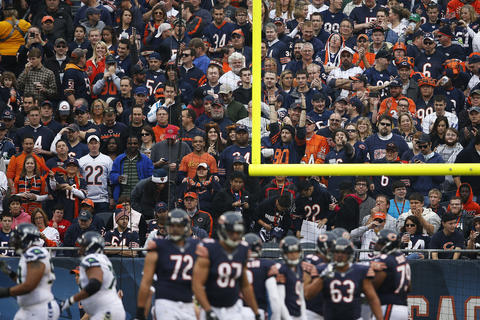 Bears fans following a point-after-attempt from kicker Robbie Gould after Earl Bennett's touchdown reception in the first quarter.