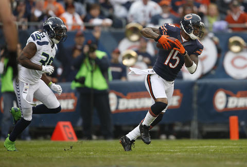 Brandon Marshall runs up field after a reception and is chased by Seahawks cornerback Brandon Browner in the first quarter.