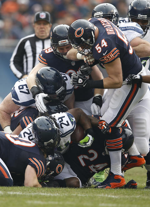 Seahawks running back Marshawn Lynch fumbles after being tackled by Brian Urlacher and other defenders in the first quarter.