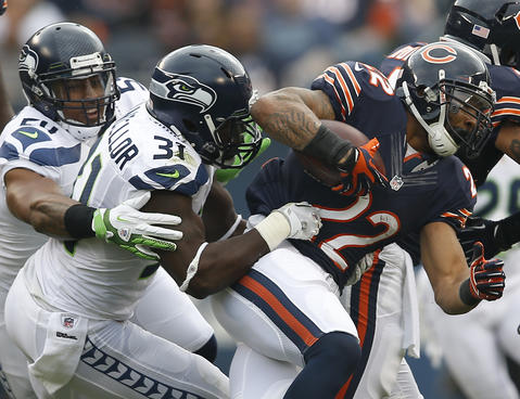 Running back Matt Forte is tackled by Seahawks strong safety Kam Chancellor and linebacker Bobby Wagner in the first quarter.