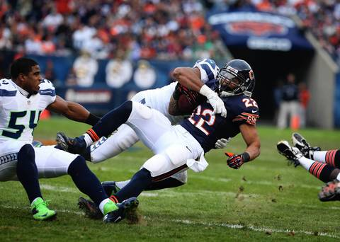 Matt Forte is brought down by the Seahawks' K.J. Wright and Bobby Wagner in the first quarter.