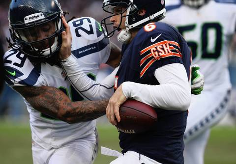 Quarterback Jay Cutler is driven out of bounds by Seahawks free safety Earl Thomas in the second quarter.