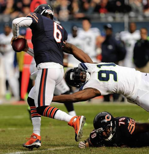 Jay Cutler tries to elude Seahawks defensive end Chris Clemons in the second quarter.