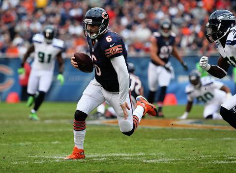 Jay Cutler scrambles for a first down in the second quarter.