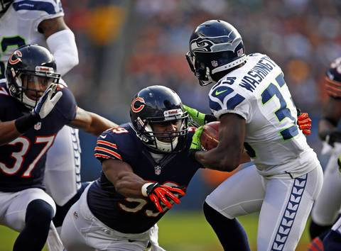 Patrick Trahan tackles Seahawks running back Leon Washington during a punt return in the second quarter.