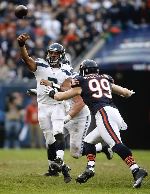 Seahawks quarterback Russell Wilson passes under pressure from Shea McClellin on the final drive of the fourth quarter.