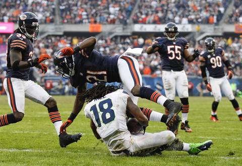 Seahawks wide receiver Sidney Rice scores the game-winning touchdown in overtime underneath safety Major Wright.