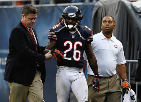 Cornerback Tim Jennings is helped off the field with an injury in overtime.