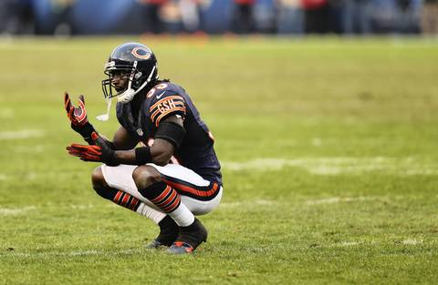 Charles Tillman reacts after a long gain on a scramble by Seahawks quarterback Russell Wilson in overtime.