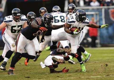Seahawks running back Marshawn Lynch runs through the Bears defense in overtime.