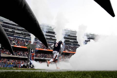 Quarterback Jay Cutler runs onto the field during player introductions.