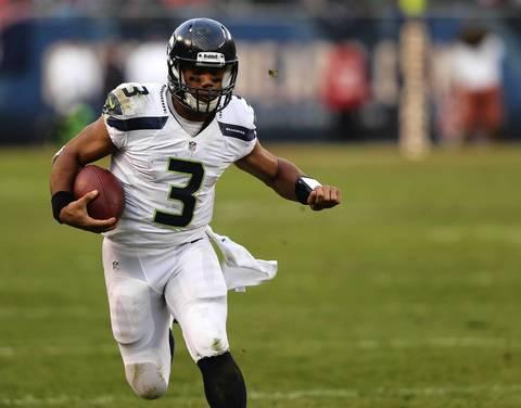 Seahawks quarterback Russell Wilson breaks free for a long run in overtime.