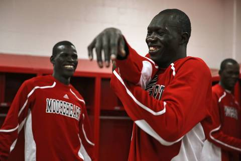 Mooseheart's Akim Nyang, center, Makur Puou, left, and Mangisto Deng prepare for home opener against Leland-Earlville on November 27, 2012.