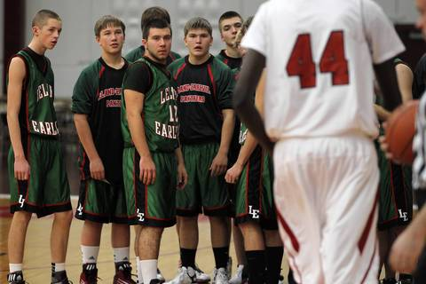 "Leland-Earlville's players stare at Mooseheart's 7' 1"" Akim Nyang before playing him in Mooseheart's home opener on Tuesday, November 27, 2012."