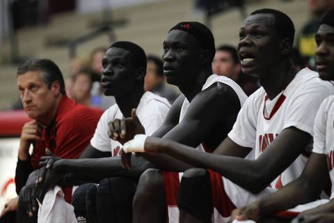 Mooseheart's Mangisto Deng, left, Makur Puou and Akim Nyang sit on the bench near coach Ron Ahrens during the school's home opener win against Leland-Earlville.