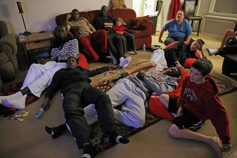 The Mooseheart basketball team enjoys movie night at coach Ron Ahrens' house on November 18, 2012.
