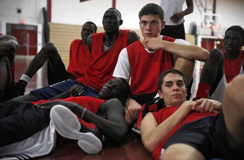 Mooseheart's Mangisto Deng, bottom left, Makur Puou, second from left, and Akim Nyang, left, joins their teammates in watching game film during practice on December 3, 2012.