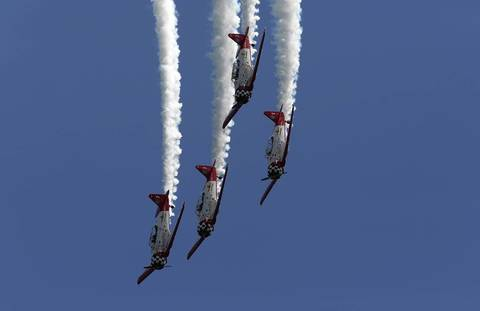The Aeroshell Aerobatic Team flies in the 54th annual Air and Water Show in Chicago.