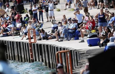 People crowd the city's lakefront between Oak Street beach and North Avenue beach for the second day of the 54th annual Air and Water Show in Chicago.