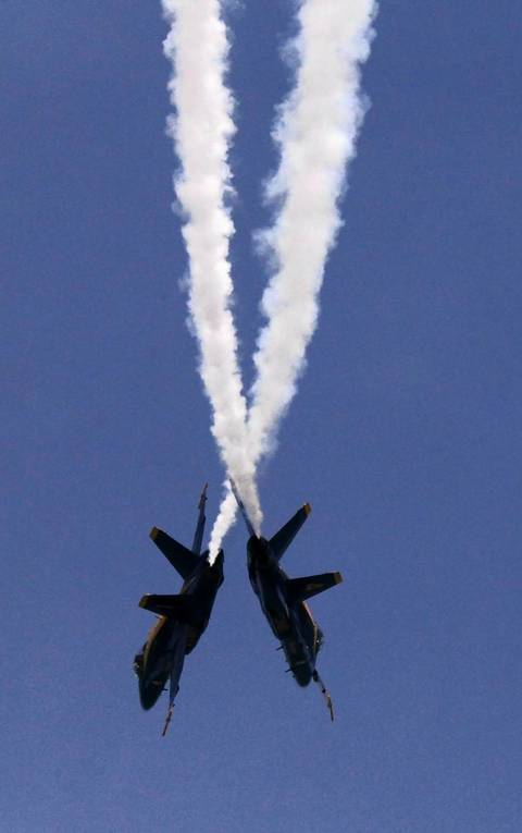Members of the Blue Angels perform an aerial maneuver during the Chicago Air and Water Show at North Avenue Beach.
