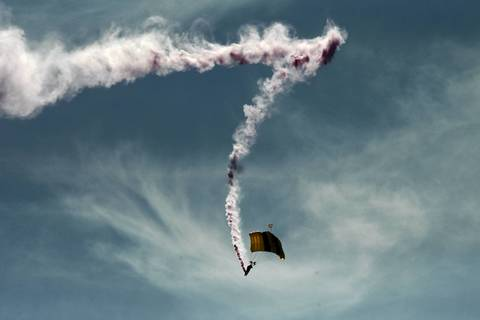 A member of the U.S. Army Golden Knights parachute team descends to North Avenue Beach during the Chicago Air and Water Show.