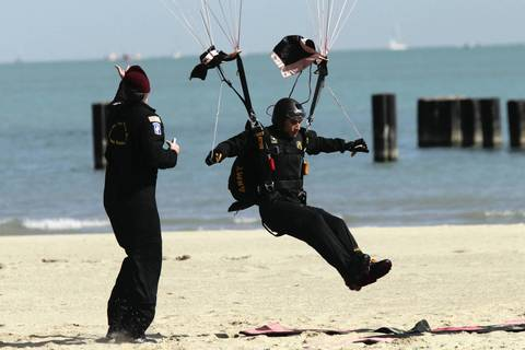 A member of the U.S. Army Golden Knights parachute team lands on North Avenue Beach at the Chicago Air and Water Show.