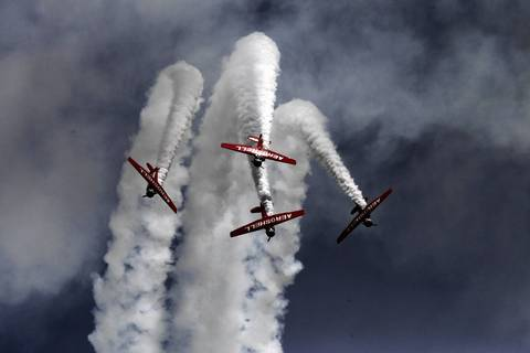 The Aeroshell flight team performs maneuvers over Lake Michigan during the Chicago Air and Water Show at North Avenue Beach.