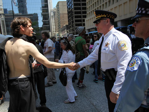 Chicago police Superintendent Garry McCarthy greets an Occupy protester from Scranton, Pa., at Daley Plaza. Occupy protesters from across the country flooded the city during the 2012 NATO summit. Go here to see our photogallery.
