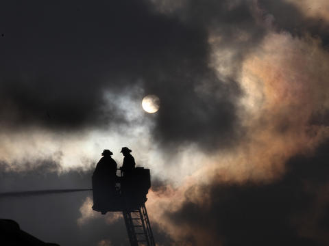 Chicago firefighters battle an extra-alarm fire at a warehouse in the Avondale neighborhood on the Northwest Side. It took more than 200 firefighters eight hours to put out the blaze. No injuries were reported.