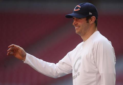 Quarterback Jay Cutler warms up Sunday.