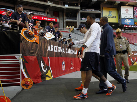 Bears fans watch Jay Cutler, Alshon Jeffrey and Brandon Marshall before the game.