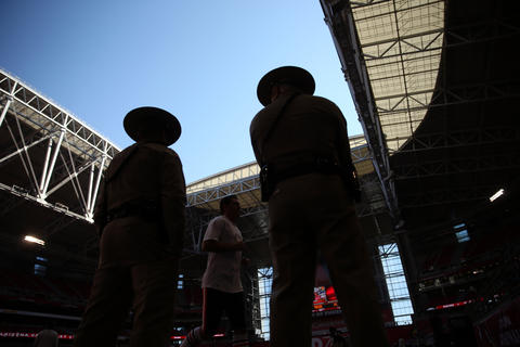 Two police officers stand by as Bears prepare to play the Cardinals.