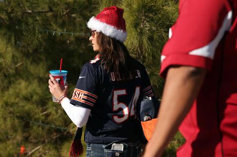 Bears fan Melissa Pilnock of Tempe walks outside University of Phoenix Stadium.