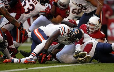 Zack Bowman recovers a fumble for a touchdown against the Cardinals in the first quarter.