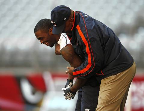 Earl Bennett gets a hug from wide receivers coach Darryl Drake before the game.