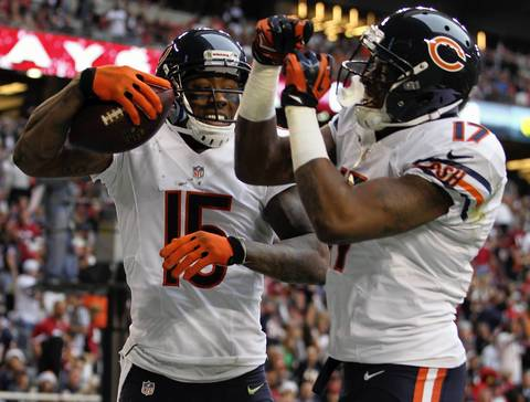 Brandon Marshall celebrates his touchdown reception with Alshon Jeffrey in the 2nd quarter.