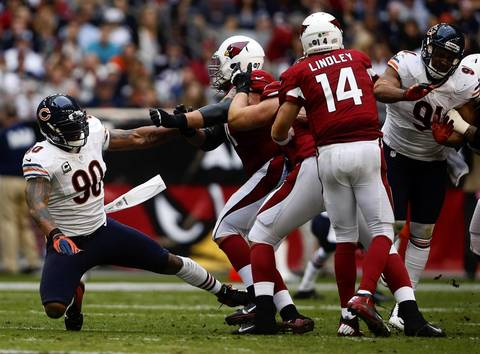 Defensive end Julius Peppers can't get to Cardinals quarterback Ryan Lindley in the second quarter.