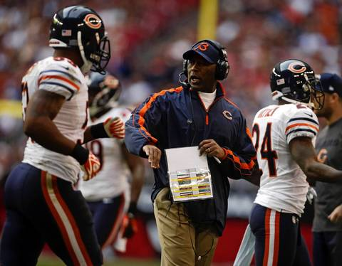 Coach Lovie Smith with his players.