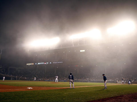 Cubs pitcher Carlos Marmol works the mound as fog rolls during the eighth inning against the Braves at Wrigley Field. The Cubs won the game 5-1.