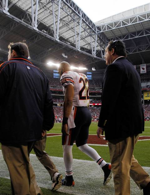 Running back Matt Forte heads into the locker room with an ankle injury against the Cardinals in the third quarter.
