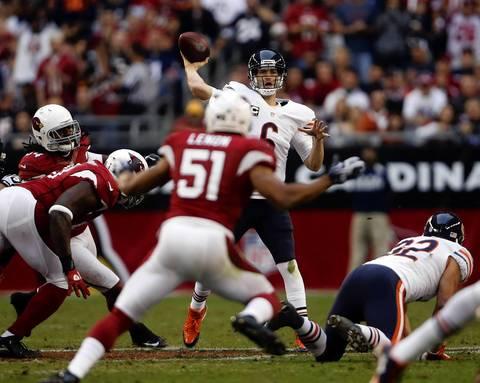 Bears quarterback Jay Cutler passes over Cardinals linebacker Paris Lenon (51) in the third quarter.