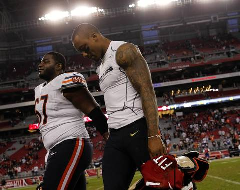 Brandon Marshall heads to the locker room after trading jerseys with Cardinals wide receiver Larry Fitzgerald.