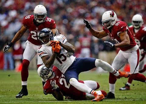 Brandon Marshall is tackled by Cardinals cornerback Patrick Peterson in the second quarter.