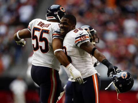 Linebackers Lance Briggs and Geno Hayes celebrate Charles Tillman's touchdown in the third quarter.