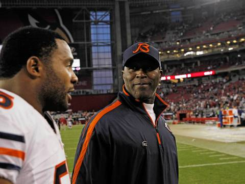 Lance Briggs and Lovie Smith head to the locker room after beating the Cardinals.