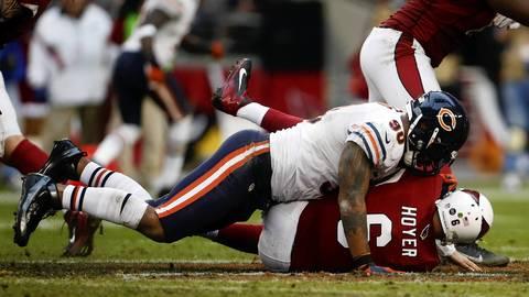 Defensive end Julius Peppers sacks Cardinals quarterback Brian Hoyer in the third quarter.