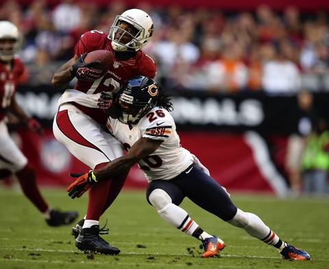 Tim Jennings tackles the Cardinals' Andre Roberts in the 1st quarter.