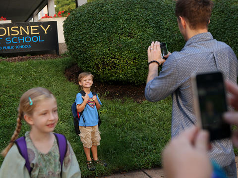 Walt Disney Magnet School students have their photos taken, the first day of classes for most Chicago students. On Sept. 10, thousands of Chicago Public Schools teachers walked off the job in their first strike in 25 years.